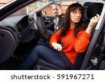 girl in orange sweater fasten a ... | Shutterstock . vector #591967271