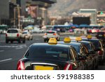 taxi stand in a row on a city... | Shutterstock . vector #591988385
