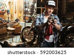 Handsome Biker Polishing Spare...
