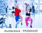 fitness instructor at the gym | Shutterstock . vector #592004105