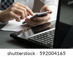 business man drinking coffee... | Shutterstock . vector #592004165