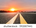 asphalt road and sky at sunset | Shutterstock . vector #592007441