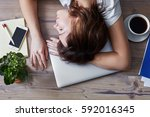 woman sleeping on the workplace.... | Shutterstock . vector #592016345