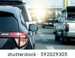 cars on the road heading... | Shutterstock . vector #592029305