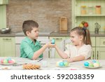 children boy and girl playing... | Shutterstock . vector #592038359