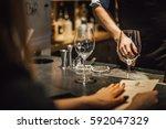 bartender making alcoholic... | Shutterstock . vector #592047329