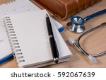 close up of stethoscope book... | Shutterstock . vector #592067639