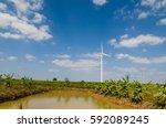 wind turbine on the blue sky... | Shutterstock . vector #592089245