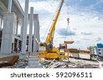 mobile crane is unloading... | Shutterstock . vector #592096511