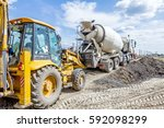 concrete mixer truck is pouring ... | Shutterstock . vector #592098299
