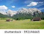 several wooden huts on a green... | Shutterstock . vector #592146665