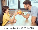 side view of happy father and... | Shutterstock . vector #592154609