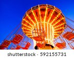 famous old carousel at the oktoberfest in munich - germany - stock photo