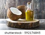coconut oil on wooden... | Shutterstock . vector #592176845
