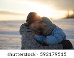mother and daughter in winter... | Shutterstock . vector #592179515