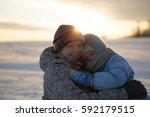 mother and daughter in winter... | Shutterstock . vector #592179515