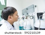 scientist check valve of gas... | Shutterstock . vector #592210139