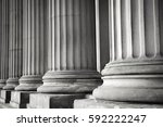 row of columns in black and... | Shutterstock . vector #592222247
