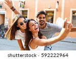 group of happy young friends... | Shutterstock . vector #592222964
