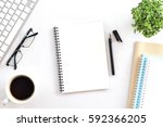 blank notebook page is on top... | Shutterstock . vector #592366205