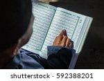 a muslim kids reciting al quran | Shutterstock . vector #592388201