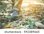 shoes man walking on a forest... | Shutterstock . vector #592389665