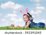 little girl with easter eggs on ... | Shutterstock . vector #592391045