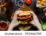 hands holding fresh delicious... | Shutterstock . vector #592466789