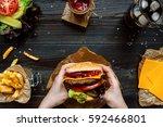hands holding fresh delicious... | Shutterstock . vector #592466801