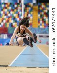 Small photo of ISTANBUL, TURKEY - DECEMBER 17, 2016: Athlete Almina Malkoc Triple Jumping during Turkish Athletic Federation Olympic Threshold Indoor Competitions