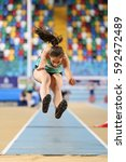 Small photo of ISTANBUL, TURKEY - DECEMBER 17, 2016: Athlete Melike Alcin Triple Jumping during Turkish Athletic Federation Olympic Threshold Indoor Competitions