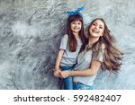 young beautiful mom with her... | Shutterstock . vector #592482407