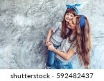 young beautiful mom with her... | Shutterstock . vector #592482437