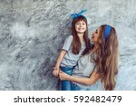 young beautiful mom with her... | Shutterstock . vector #592482479