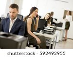 young people working in the... | Shutterstock . vector #592492955