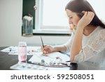 girl painter in white dress... | Shutterstock . vector #592508051