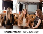 young friends in a cafe | Shutterstock . vector #592521359