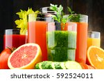 glasses with fresh organic... | Shutterstock . vector #592524011