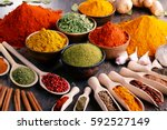 variety of spices and herbs on... | Shutterstock . vector #592527149