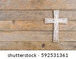 white cross on old wood... | Shutterstock . vector #592531361
