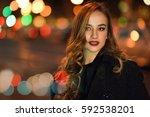 beautiful young girl wearing... | Shutterstock . vector #592538201