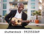 Black Smiling Man Wearing...