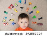 toddler boy playing with car... | Shutterstock . vector #592553729