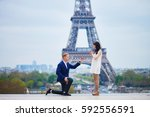 romantic engagement in paris ... | Shutterstock . vector #592556591
