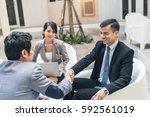 business people shake hand in... | Shutterstock . vector #592561019