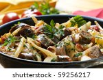 Casserole with sausages and vegetables, slow-cooked. - stock photo