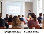 female speaker giving... | Shutterstock . vector #592565951