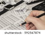 black pencil in hand and office ... | Shutterstock . vector #592567874