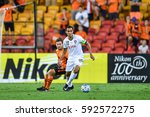 Small photo of Teerasil Dangda (white) of Muangthong United in action during the AFC Champions League between Brisbane Roar and Muangthong United at Suncorp Stadium on February 21, 2017 in Australia.