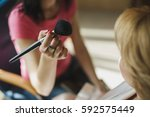 stylist making make up bride on ... | Shutterstock . vector #592575449